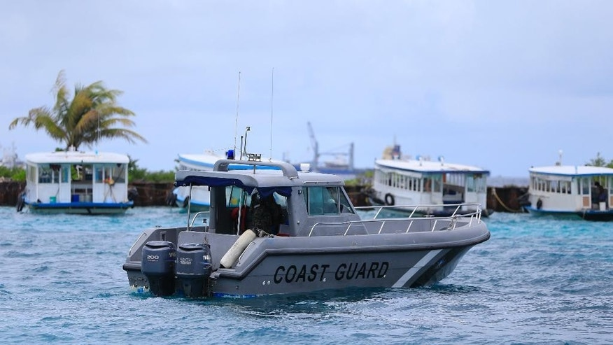 A Coast Guard vessel patrols the area before the arrival of Vice President Ahmed Adheeb near the International Airport in Male, Maldives, Saturday, Oct. 24, 2015. Police say Adeeb has been arrested on suspicion of links to a blast on the presidential boat last month. (AP Photo/Sinan Hussain)