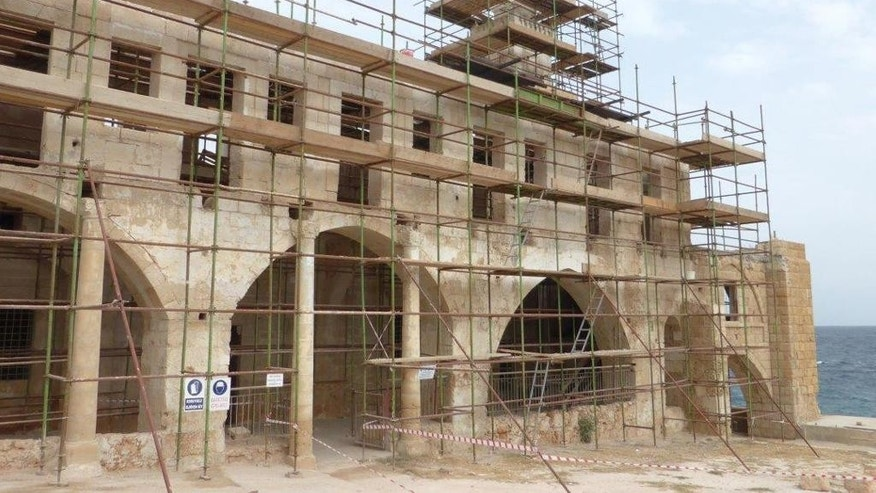 This photo provided by the UNDP-PFF in Cyprus on Friday, Oct. 23, 2015, shows the Apostolos Andreas monastery in Karpasia at the Turkish Cypriot breakaway northern part of the island as it undergoes restoration works. Work to restore a Cypriot monastery on the divided island of Cyprus has brought Turkish Cypriots together with Greek Cypriots, and Muslims with Christians. Lore stretching back to the dawn of Christianity says this monastery sits directly over a fresh-water spring that one of Jesus' first disciples, St. Andrew, created while waiting for winds to pick up so he could continue his ship-borne travels. (UNDP-PFF via AP)