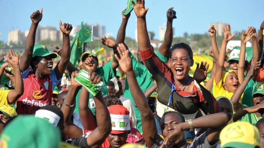Supporters of presidential candidate John Magufuli of the ruling Chama Cha Mapinduzi (CCM) party, cheer at an election rally in Dar es Salaam, Tanzania, Friday, Oct. 23, 2015. Tanzanians vote Sunday in landmark elections that could end the dominance of the ruling party, which has held power for decades but faces a united opposition buoyed by growing discontent over official corruption. (AP Photo/Khalfan Said)