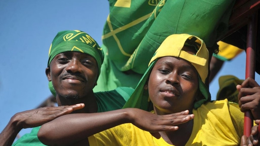 Supporters of presidential candidate John Magufuli of the ruling Chama Cha Mapinduzi (CCM) party, chant and dance at an election rally in Dar es Salaam, Tanzania Friday, Oct. 23, 2015. Tanzanians vote Sunday in landmark elections that could end the dominance of the ruling party, which has held power for decades but faces a united opposition buoyed by growing discontent over official corruption. (AP Photo/Khalfan Said)