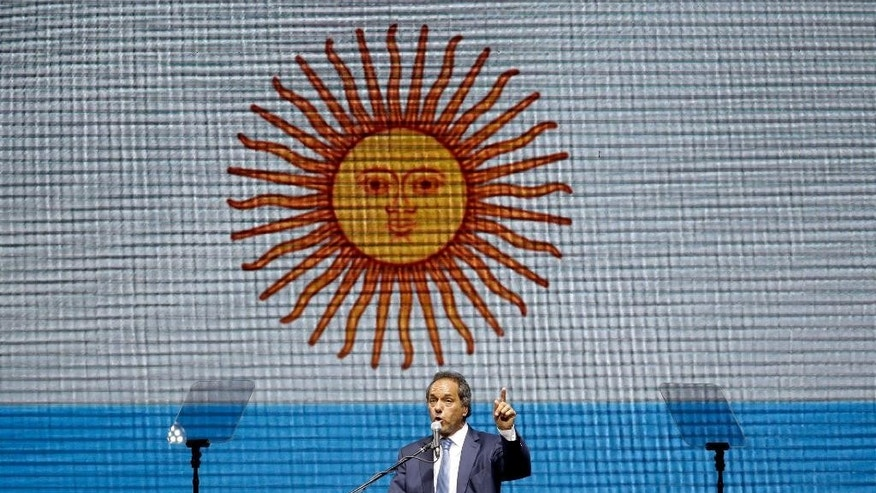 Buenos Aires' Governor and ruling party presidential candidate Daniel Scioli talks to supporters at his closing campaign rally in Buenos Aires, Argentina, Thursday, Oct. 22, 2015. Scioli, President Cristina Fernandez' hand-picked successor, is leading in the polls for Sunday's presidential elections. (AP Photo/Natacha Pisarenko)