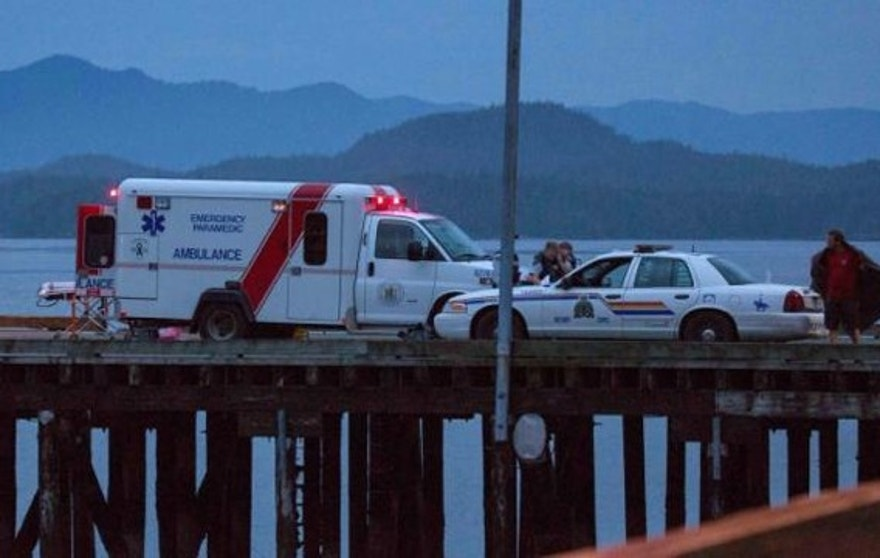 Oct. 25, 2015: Rescue personnel mounting a search for victims of a capsized whale watching boat park on a wharf in Tofino, British Columbia. (Reuters/Adam Chilton)