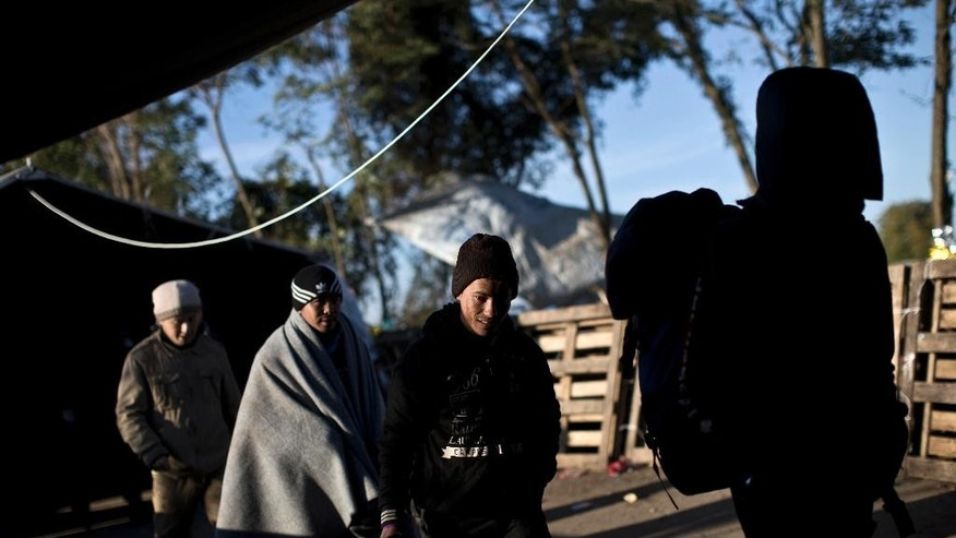 Migrants pass through tents as they are about to cross Serbia's border with Croatia, in Berkasovo, Serbia, Sunday, Oct. 25, 2015. Thousands of migrants and refugees are still crossing from Serbia into Croatia and continuing their journey towards Western Europe. (AP Photo/Marko Drobnjakovic)