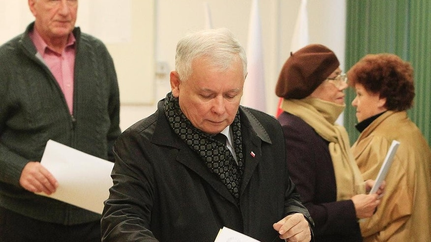 Jaroslaw Kaczynski, the leader of the conservative opposition Law and Justice party casts his ballot in Poland's general elections in Warsaw, Poland on Sunday, Oct. 25, 2015. Opinion polls showed Law and Justice ahead of the ruling Civic Platform party, but voters in Warsaw were also voting for new, small left- and rightwing parties, while being critical of the establishment. (AP Photo/Czarek Sokolowski)