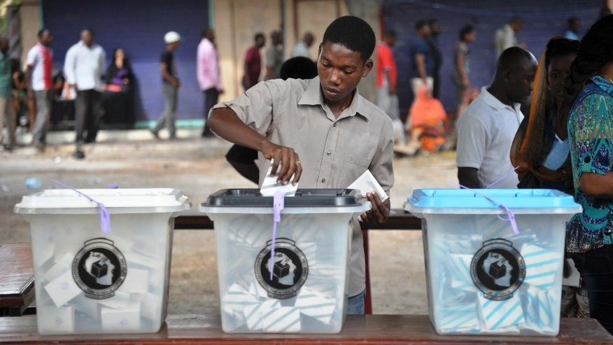 A Tanzanian man casts his vote in the presidential election at a polling station in Dar es Salaam, Tanzania Sunday, Oct. 25, 2015. Voting has started in Tanzania's general elections in which the ruling party faces a strong challenge from a united opposition. (AP Photo/Khalfan Said)