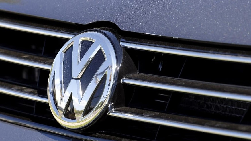 FILE - In this Sept. 24, 2015, file photo, the grille of a Volkswagen car for sale is decorated with the iconic company symbol in Boulder, Colo.  J.D. Power says Volkswagen Group's sales are expected to be flat in October, 2015, even as sales for the U.S. auto industry climb 8 percent toward what could be of the best Octobers in more than a decade. (AP Photo/Brennan Linsley, File)