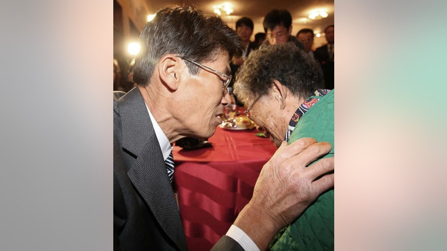 North Korean Jong Kun Mok, left, whispers to his South Korean mother Lee Bok-soon after the Separated Family Reunion Meeting at the Diamond Mountain resort in North Korea, Monday, Oct. 26, 2015. The South Korean government says that Jong was one of more than 20 crew members of a South Korean fishing ship who were abducted by the North in 1972 while fishing near the western maritime border between the countries. Seoul believes about 500 South Koreans have been abducted by the North since the end of the war and says it has lost track of most of these people. The North denies abducting South Koreans, but has allowed some individuals Seoul says were kidnapped to meet their relatives in reunions.(Kim Do-hoon/Yonhap via AP) KOREA OUT
