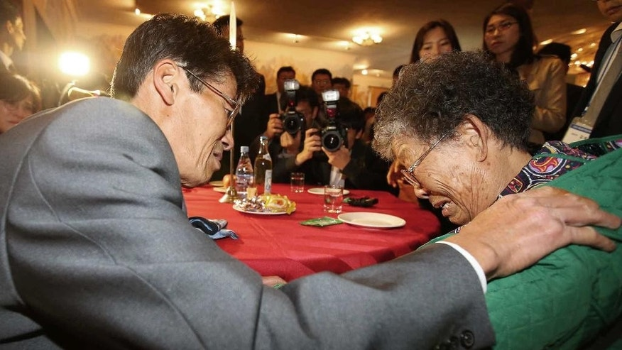 North Korean Jong Kun Mok, left, weeps with his South Korean mother Lee Bok-soon after the Separated Family Reunion Meeting at the Diamond Mountain resort in North Korea, Monday, Oct. 26, 2015. The South Korean government said that Jong was one of more than 20 crew members of a South Korean fishing ship who were abducted by the North in 1972 while fishing near the western maritime border between the countries. Seoul believes about 500 South Koreans have been abducted by the North since the end of the war and says it has lost track of most of these people. The North denies abducting South Koreans, but has allowed some individuals Seoul says were kidnapped to meet their relatives in reunions.(Kim Do-hoon/Yonhap via AP) KOREA OUT