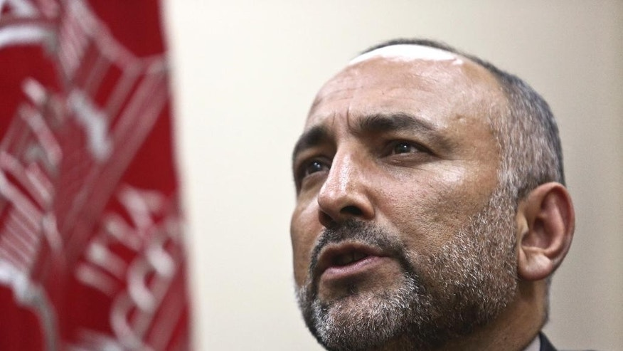 In this Saturday, Oct. 24, 2015, photo, Afghan National Security Adviser Mohammad Hanif Atmar speaks during an interview with The Associated Press, in Kabul, Afghanistan. According to Atmar, Afghanistan is in danger of once again becoming a safe haven for terrorists wanting to carry out attacks like the Sept. 11, 2001 atrocities in the United States, and needs the help of the U.S. and NATO countries to ensure victory in its fight to eliminate these groups from within its borders. (AP Photo/Rahmat Gul)