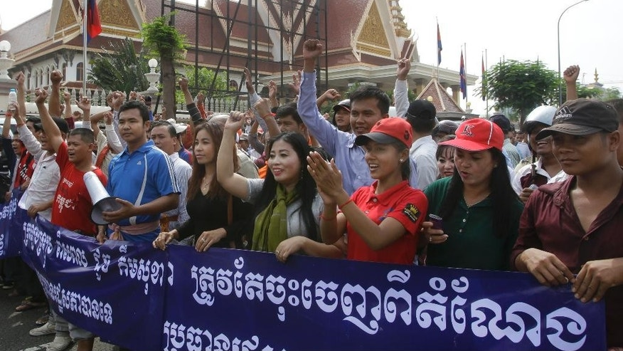 "Pro-ruling party demonstrators stage a protest rally in front of the National Assembly in Phnom Penh, Cambodia, Monday, Oct. 26, 2015. Two members of Cambodia's opposition party have been beaten outside the National Assembly allegedly by protesters demanding the deputy opposition leader step down from his post as the parliament's vice president. A banner reads: ""remove Kem Sokha from the position."" (AP Photo/Heng Sinith)"