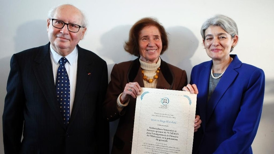 "From Left, Serge Klarsfeld, 80, a French historian, lawyer and Holocaust survivor, and his 76-year-old German-born wife Beate Klarsfeld, along with Director-General of UNESCO, Irina Bokova pose after being named UN special envoys and honorary ambassadors on genocide prevention at Unesco headquarters in Paris, Monday, Oct, 26, 2015. The U.N. Educational, Scientific and Cultural Organization praised the pair for their tireless support for the cause of the descendants of deported Jews and ""their wake-up call to societies to recognize their historical and moral responsibilities"" after World War II. (AP Photo/Francois Mori)"