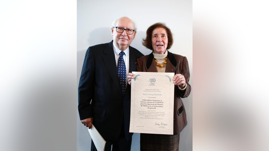 "Serge Klarsfeld, 80, a French historian, lawyer and Holocaust survivor, and his 76-year-old German-born wife Beate Klarsfeld, pose after being named UN special envoys and honorary ambassadors on genocide prevention at Unesco headquarters in Paris, Monday, Oct, 26, 2015. The U.N. Educational, Scientific and Cultural Organization praised the pair for their tireless support for the cause of the descendants of deported Jews and ""their wake-up call to societies to recognize their historical and moral responsibilities"" after World War II. (AP Photo/Francois Mori)"