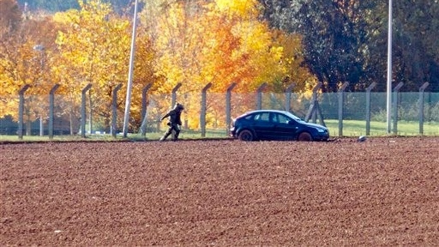Belgian media report a car attempted to crash through the gates of an army barracks and that shots have been fired. (AP Photo/Virginia Mayo)
