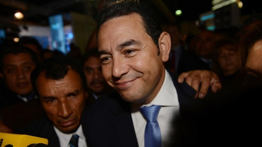 Jimmy Morales, the National Front of Convergence party presidential candidate, arrives to the Electoral Supreme Court headquarters in Guatemala City, Sunday, Oct. 25, 2015. Morales, a TV comedian, was elected as Guatemala's next president in a landslide Sunday, riding a wave of popular anger against the political class after huge anti-corruption protests helped oust the last government. (AP Photo/Oliver de Ros)