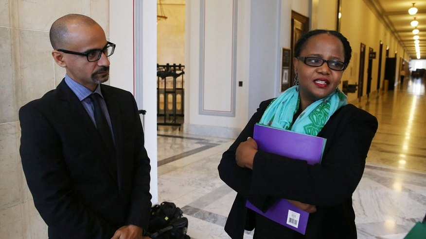 WASHINGTON, DC - OCTOBER 21:  Award winning writers Junot Diaz (L) and writer Edwidge Danticat (R) talk after meeting with members of Congress on Capitol Hill, October 21, 2015 in Washington, DC. The renowned writers called on Congress and congressional staff to push the U.S. government into applying pressure to end this human rights crisis in the Dominican Republic that is wreaking havoc on hundreds of thousands lives.  (Photo by Mark Wilson/Getty Images)