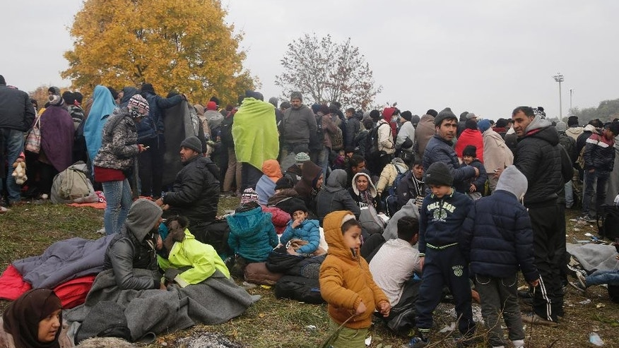 Hundreds of migrants wait to enter a camp in Spielfeld, Austria, Monday, Oct. 26, 2015. Thousands of people trying to reach central and northern Europe via the Balkans often have to wait for days in the cold rain and mud at the borders. (AP Photo/Petr David Josek)