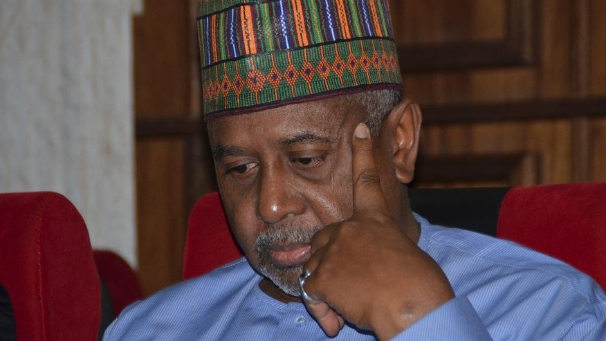 FILE- In this  Tuesday, Sept.1, 2015 file photo, Nigeria's former national security adviser Sambo Dasuki attends a hearing to face charges of possessing weapons illegally, at the Federal High Court in Abuja, Nigeria. Nigeria's former national security adviser pleaded not guilty to money laundering Monday in connection with $423,000 in U.S. dollars and Nigerian naira seized at his homes. (AP Photo file)