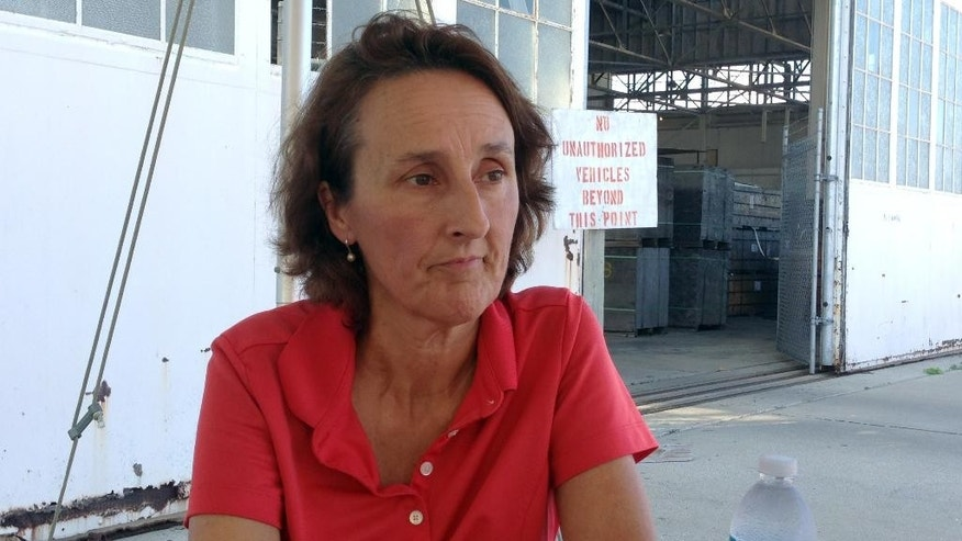 In this Friday, Oct. 23, 2015 photo, Colleen Kelly, whose brother Bill was killed at the World Trade Center on Sept. 11, speaks to reporters during a break in pretrial proceedings against five prisoners charged in the terrorist attack, in the Guantanamo Bay U.S. Naval Base, Cuba. Kelly has closely followed each new development as the case lurched along since the men were brought to this U.S. base in Cuba in 2006 from clandestine overseas CIA detention centers. (AP Photo/Ben Fox)