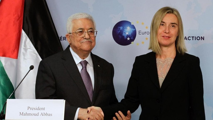 European Union High Representative Federica Mogherini, right, greets Palestinian President Mahmoud Abbas prior to a meeting at the EU External Action Service building in Brussels on Monday, Oct. 26, 2015. (AP Photo/Francois Walschaerts)