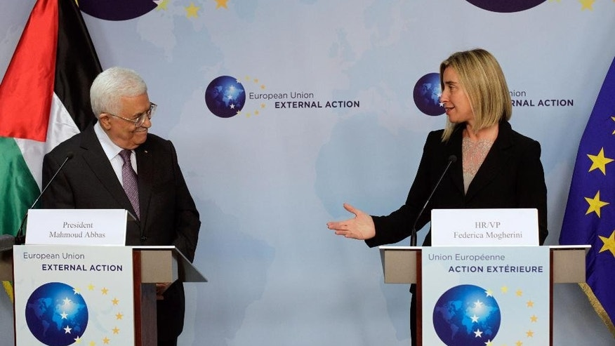 European Union High Representative Federica Mogherini, right, participates in a media conference with Palestinian President Mahmoud Abbas after a meeting at the EU External Action Service building in Brussels on Monday, Oct. 26, 2015. (AP Photo/Francois Walschaerts)