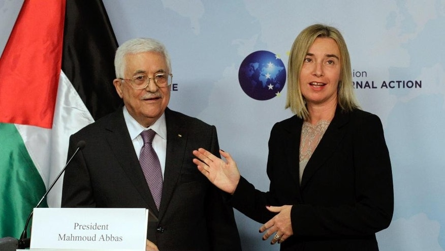 European Union High Representative Federica Mogherini, right, speaks with Palestinian President Mahmoud Abbas prior to a meeting at the EU External Action Service building in Brussels on Monday, Oct. 26, 2015. (AP Photo/Francois Walschaerts)