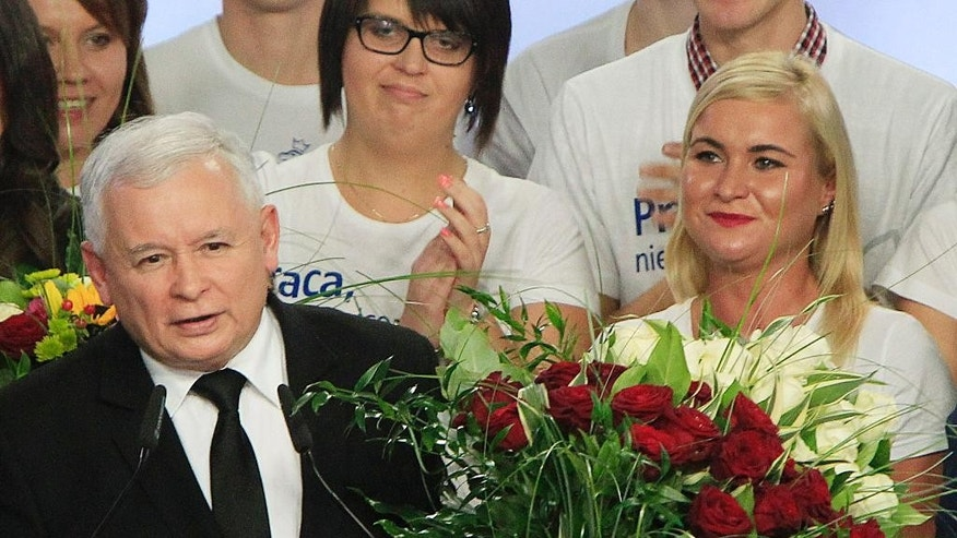 Jaroslaw Kaczynski, left, leader of the conservative opposition Law and Justice party announces victory in the general elections in Poland at the party's headquarters in Warsaw, Poland, on Sunday, Oct.25, 2015. The victory of his Eurosceptic party ends eight years in power of pro-EU, pro-business Civic Platform which voters accuse of being conformist, detached and focused on power rather than on improving the living in Poland.(AP Photo/Czarek Sokolowski)
