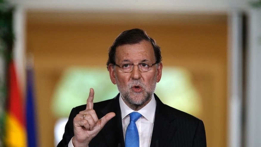 Spanish Prime Minister Mariano Rajoy talks to journalists during a news conference following a cabinet meeting at the Moncloa palace, the premier's official resident, in Madrid, Monday, Oct. 26, 2015. Rajoy on Monday signed a decree formally dissolving Parliament and calling general elections Dec. 20, using the occasion to do some campaigning by praising his government's handling of the severe economic crisis. (AP Photo/Francisco Seco)