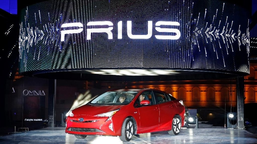 FILE - In this Sept. 8, 2015 file photo, Toyota unveils the latest version of the Prius at an event in Las Vegas. Toyota remained the top automaker in global vehicle sales after the first nine months of this year, selling nearly 7.5 million vehicles, outpacing rivals General Motors and Volkswagen. Toyota Motor Corp.'s global sales for the first three quarters totaled 7.498 million vehicles, down 1.5 percent from the same period the previous year, according to numbers released Monday, Oct. 26, 2015. (AP Photo/John Locher, File)