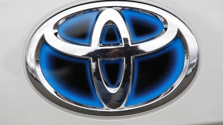 FILE - This March 30, 2011 file photo shows the Toyota logo is shown on a Prius in Wilsonville, Ore. Toyota remained the top automaker in global vehicle sales after the first nine months of this year, selling nearly 7.5 million vehicles, outpacing rivals General Motors and Volkswagen. Toyota Motor Corp.'s global sales for the first three quarters totaled 7.498 million vehicles, down 1.5 percent from the same period the previous year, according to numbers released Monday, Oct. 26, 2015.  (AP Photo/Rick Bowmer, File)