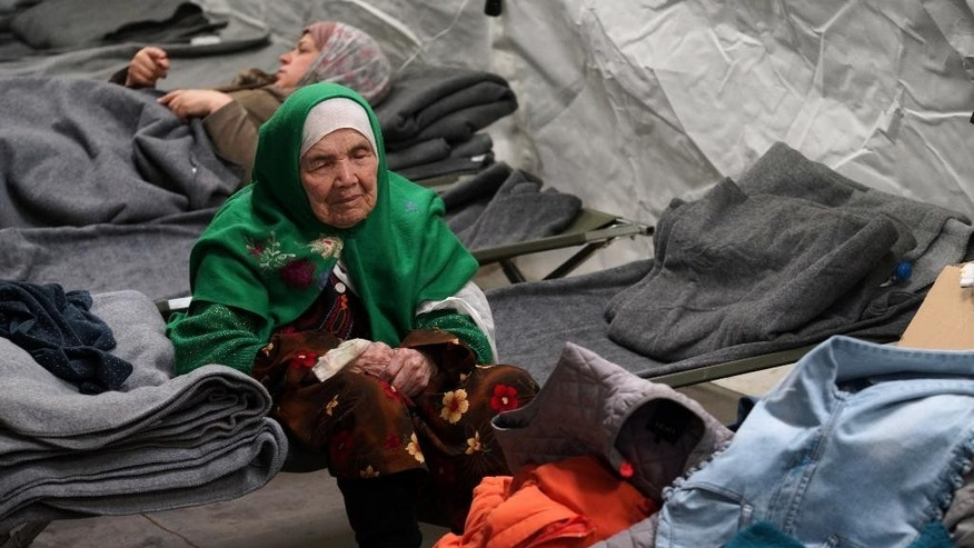105-year old Afghan woman. Bibihal Uzbeki from Kunduz, Afghanistan, rests in Croatia's main refugee camp at Opatovac, Croatia, near the border with Serbia, Tuesday, Oct. 27, 2015.  Centenarian Bibihal Uzbeki, crossed into Croatia on a stretcher from Serbia with a large group of refugees, including her son and several other relatives, among tens of thousands who have traveled across continents, fleeing war and poverty to search for a happier, safer future in Europe. (AP Photo/Marjan Vucetic)