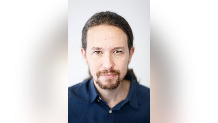 In this photo taken on Thursday, Oct. 15, 2015, Podemos ('We Can') party leader Pablo Iglesias poses for pictures after an interview with The Associated Press, in Madrid. The hard-left Podemos party, the pony-tailed professor co-founded last year became a surprise winner of seats in the European Parliament, just a few months after it was formed. Buoyed by growing momentum driven by rage against austerity, Iglesias is now poised to lead the party into Spain's Parliament and disrupt its historical order. (AP Photo/Daniel Ochoa de Olza)