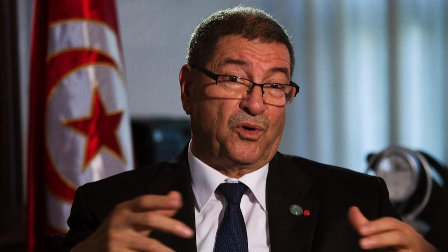 Tunisian Prime Minister Habib Essid speaks with The Associated Press during an interview ahead of a two-day conference in Madrid on combating the type of terrorism targeting foreign tourists that has hit his country twice over the last year, Spain, Tuesday, Oct. 27, 2015. (AP Photo/Emilio Morenatti)