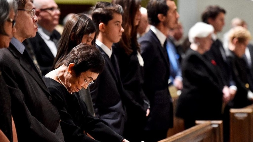 Pat Taylor looks down at the funeral of her husband, Ken Taylor, Canada's former ambassador to Iran, in Toronto, on Tuesday, Oct. 27, 2015. Taylor, Canada's former ambassador to Iran who sheltered Americans at his residence during the 1979 hostage crisis, died on Oct. 16 of colon cancer. (Nathan Denette/The Canadian Press via AP)