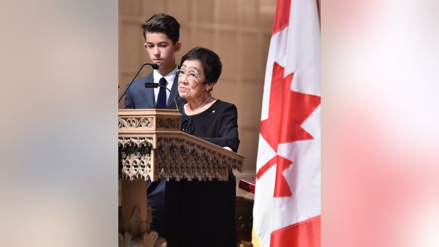 Pat Taylor, Ken Taylor's widow, speaks at the funeral of the former diplomat in Toronto on Tuesday, Oct. 27, 2015. Taylor was Canada's ambassador to Iran in 1979 when he helped six Americans escape the country during the hostage crisis. (Nathan Denette/The Canadian Press via AP)