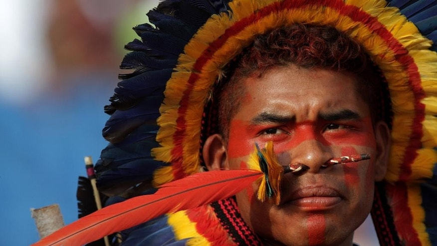 A Brazilian Indian Bororo attends a competition at the World Indigenous Games, in Palmas, Brazil, Monday, Oct. 26, 2015. Billed as the indigenous Olympics, the games are expected to attract nearly 2,000 athletes from dozens of Brazilian ethnicity, as well as from such far-flung nations as Ethiopia and New Zealand. (AP Photo/Eraldo Peres)
