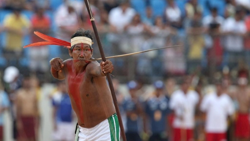 A Brazilian Gaviao Indian takes part in the bow and arrow competition at the World Indigenous Games, in Palmas, Brazil, Sunday, Oct. 25, 2015. Billed as the indigenous Olympics, the games are expected to attract nearly 2,000 athletes from dozens of Brazilian ethnicities, as well as from such far-flung nations as Ethiopia and New Zealand. (AP Photo/Eraldo Peres)