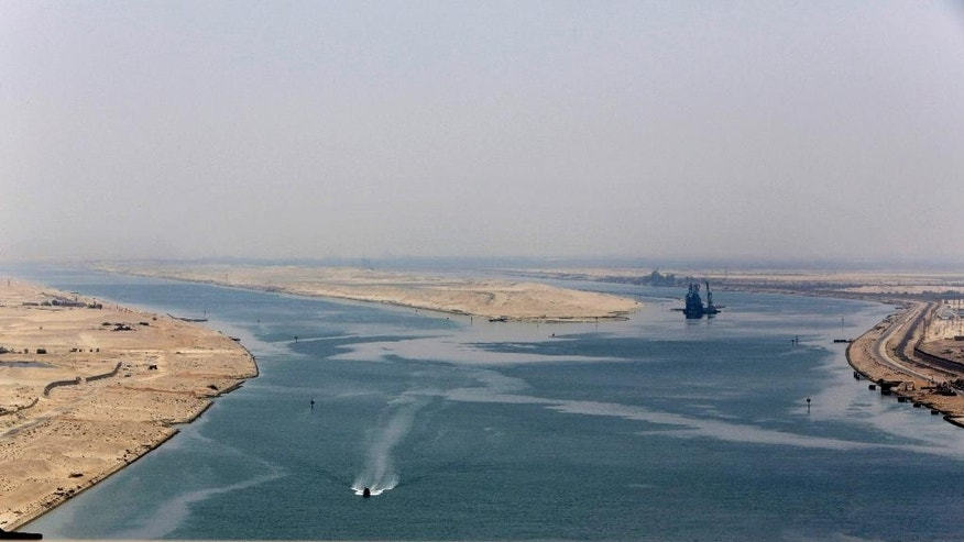 FILE - In this Aug. 6, 2015 file photo, an army zodiac secures the entrance of the new section of the Suez Canal in Ismailia, Egypt. Toll revenues for Egypt's Suez Canal fell in September 2015, dampening hopes that a new parallel waterway -- which authorities claimed would more than double canal income in the next seven years -- will boost the economy in the immediate future. Data released on Monday, Oct. 25, 2015, by canal authorities shows that monthly revenue was $448.8 million in September, down some $13 million from the previous month. (AP Photo/Amr Nabil, File)