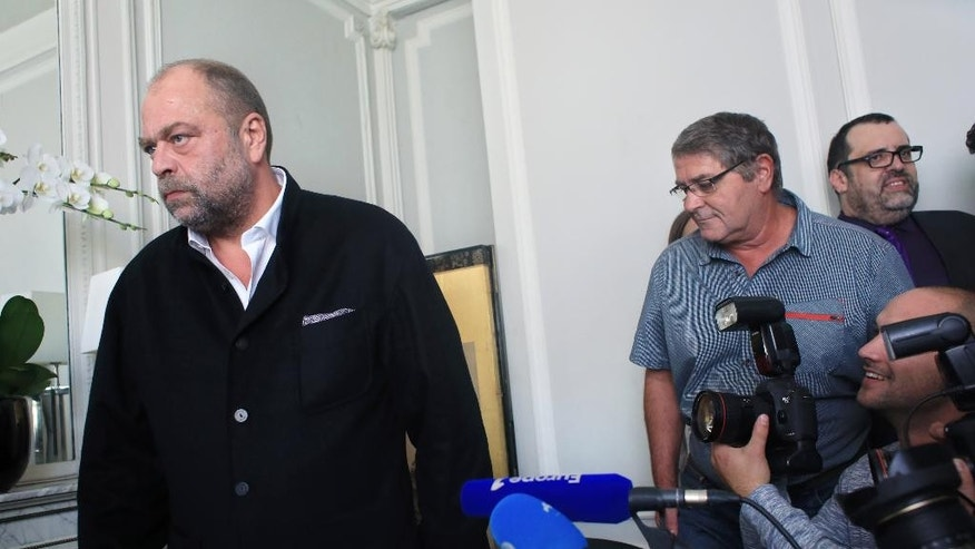 French pilot Pascal Jean Fauret, right, arrives with his lawyer Eric Dupond Moretti, left, for a press conference, in Paris, Tuesday, Oct. 27, 2015, following his daring escape from Dominican Republic. Two French pilots, Pascal Jean Fauret and Bruno Odos, were facing 20-years in a Dominican Republic prison for alleged cocaine trafficking, before they made a daring escape, sneaking home across the Atlantic. (AP Photo/Thibault Camus)