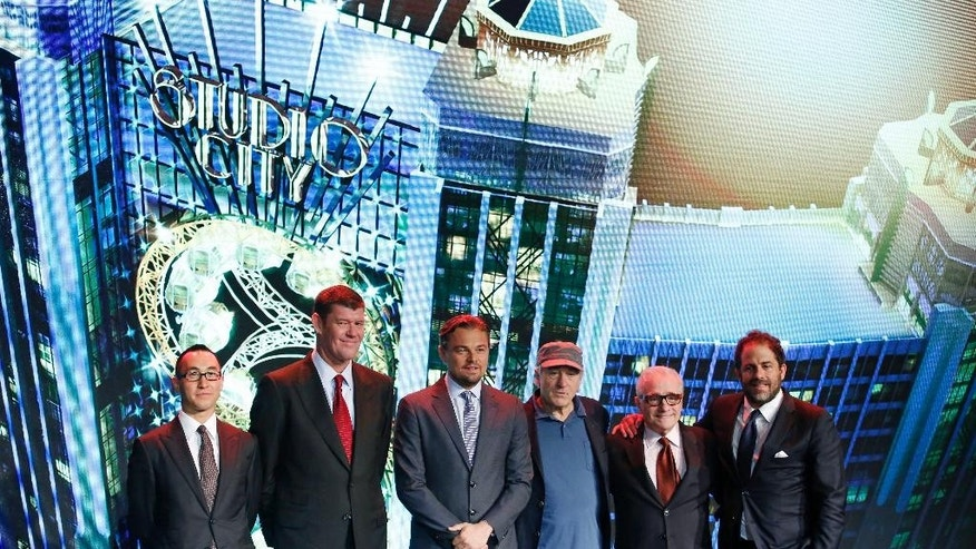 From left, Melco Crown Entertainment's co-chairman and chief executive officer Lawrence Ho and co-chairman James Packer pose with film stars Leonardo DiCaprio, Robert De Niro, director Martin Scorsese and producer Brett Ratner during a launch ceremony of the Studio City project in Macau, Tuesday, Oct. 27, 2015. China's world-beating gambling hub is getting a taste of Hollywood glamor as its newest casino resort makes its debut on Tuesday with a glitzy grand opening that masks turmoil behind the scenes. (AP Photo/Kin Cheung)