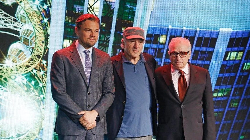From left, film stars Leonardo DiCaprio, Robert De Niro and director Martin Scorsese pose for photos during a launching ceremony of the Studio City project in Macau, Tuesday, Oct. 27, 2015. China's world-beating gambling hub is getting a taste of Hollywood glamor as its newest casino resort makes its debut on Tuesday with a glitzy grand opening that masks turmoil behind the scenes. (AP Photo/Kin Cheung)