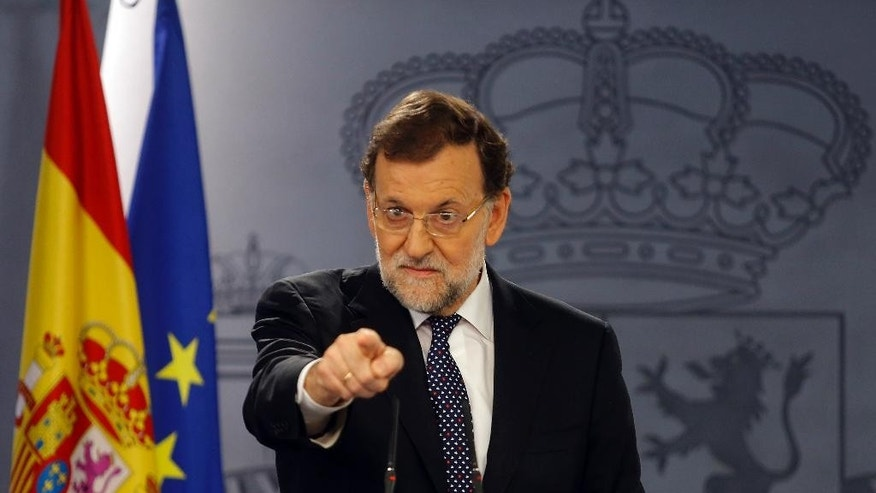 Spanish Prime Minister Mariano Rajoy points out as he delivers a statement at the Moncloa palace, the premier's official resident, in Madrid, Tuesday, Oct. 27, 2015. Rajoy promised Tuesday to defend Spain's unity by all legal means and said a proposal by two secessionist parties to have Catalonia's regional parliament announce the formal start of independence and the formation of a new republican state of Catalonia will have no effect. (AP Photo/Francisco Seco)