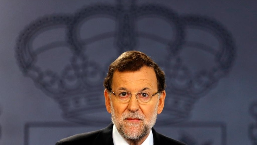 Spanish Prime Minister Mariano Rajoy pauses as he delivers a statement at the Moncloa palace, the premier's official resident, in Madrid, Tuesday, Oct. 27, 2015. Rajoy promised Tuesday to defend Spain's unity by all legal means and said a proposal by two secessionist parties to have Catalonia's regional parliament announce the formal start of independence and the formation of a new republican state of Catalonia will have no effect. (AP Photo/Francisco Seco)