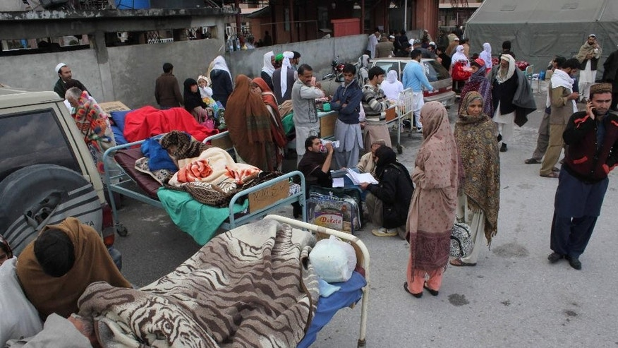 People injured from an earthquake receive treatment outside the Ayub Medical Hospital in Abbotabad, Pakistan, Monday, Oct. 26, 2015. One of Afghanistan's most isolated and poverty-stricken regions was hit by a massive earthquake on Monday that reverberated across Asia, shaking buildings from Kabul to New Delhi, cutting power and communications, and killing almost 200 people, mostly in the remote mountain regions near the Afghan-Pakistan border. The number of casualties on both side of the border was expected to rise. (AP Photo/Aqeel Ahmed)