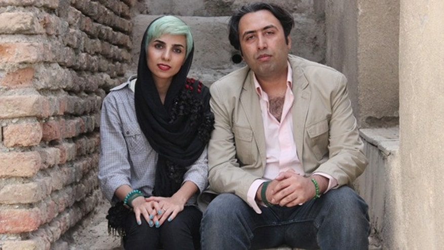 Iranian poets Fatemeh Ekhtesari , left, and Mehdi Mousavi pose in unknown place in Iran.