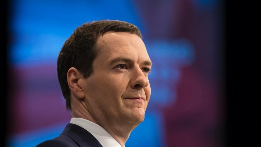 "FILE- In this file photo dated Monday Oct. 5, 2015, Britain's Chancellor of the Exchequer George Osborne gives a speech during the Conservative Party Conference, in Manchester, England.  Britain's government on Tuesday Oct. 27, 2015, is reviewing the powers of the House of Lords after unelected peers stalled legislation that would have eliminated some tax allowances for the nation's poor, and Osborne says the consequences of the government's defeat would ""need to be dealt with.""(AP Photo/Jon Super, FILE)"