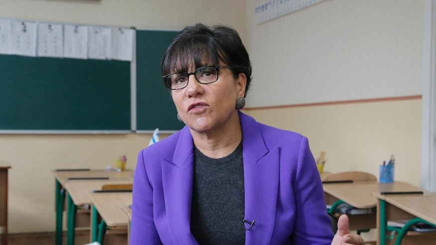 U.S. Commerce Secretary Penny Pritzker talks with reporters during an interview with the Associated Press  in a Jewish school  in the Ukrainian town of Bila Tserkva, where some of her distant relatives once lived in Ukraine, Tuesday, Oct. 27, 2015. (AP Photo/Efrem Lukatsky)