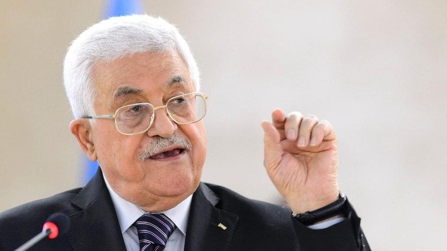 Palestinian President Mahmoud Abbas, addresses the UN Human Rights Council during a meeting at the European headquarters of the United Nations, in Geneva, Switzerland Wednesday Oct. 28, 2015. (Martial Trezzini/Keystone via AP)