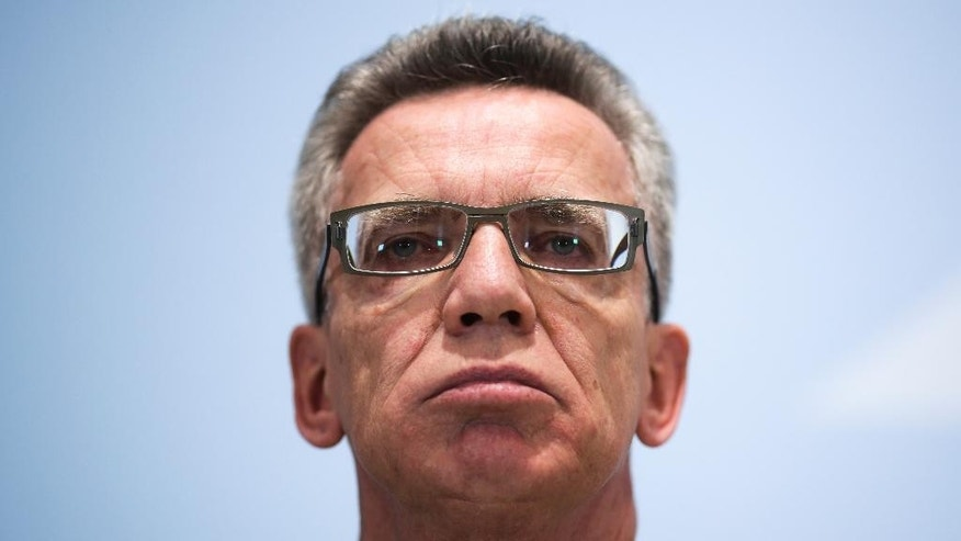 German Interior Minister Thomas de Maiziere briefs the media during a news conference at the Interior Ministry in Berlin, Wednesday, Oct. 28, 2015. Germany's Interior Minister says many of the Afghans pouring into the country will most likely be sent back to their homeland. Thomas de Maiziere says Germany and other western nations have poured millions in developmental aid into Afghanistan, as well as sending troops and police to help train security forces there, and that Afghanistan's government agrees with Berlin that citizens should stay and help rebuild the country.  (AP Photo/Markus Schreiber)