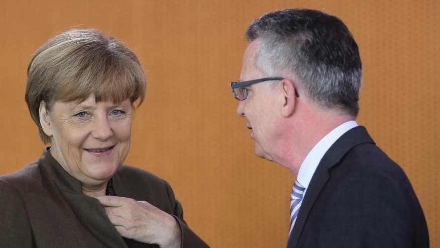 German Chancellor Angela Merkel, left, talks to Interior Minister Thomas de Maiziere at the weekly cabinet meeting at the chancellery, in Berlin, Wednesday, Oct. 28, 2015. (AP Photo/Markus Schreiber)
