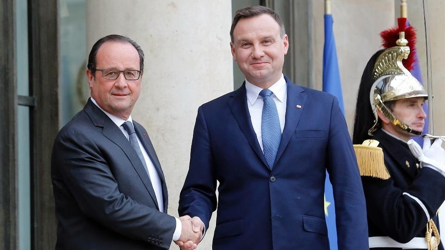 French President Francois Hollande, left, shakes hands with Polish President Andrzej Duda before their talks at the Elysee Palace in Paris, Wednesday, Oct.28, 2015. (AP Photo/Jacques Brinon)